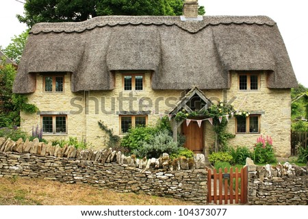 Traditional quaint cottage in Cotswolds, England - stock photo