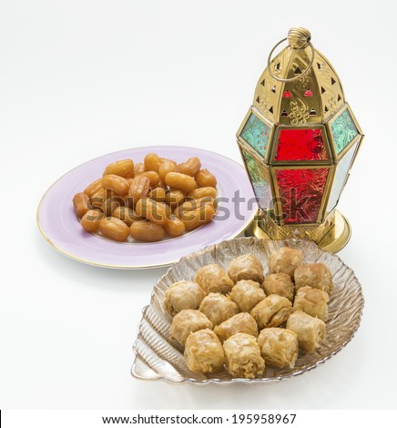 Traditional Ramadan lantern and assorted arabic sweets - isolated objects - stock photo