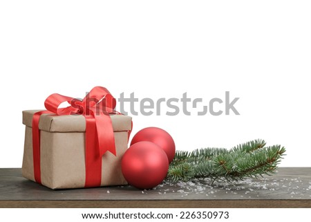 traditional red balls and fir branch on wood table, white background - stock photo