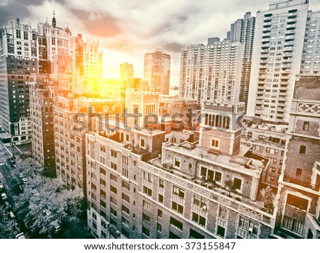Traditional red brick apartments in Manhattan New York sunset - stock photo