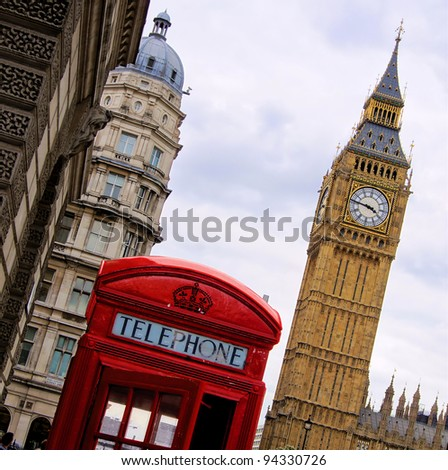 Traditional red English telephone box with the Tower of Big Ben - stock photo