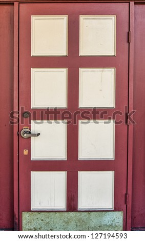 Traditional red painted grunge wooden door - stock photo