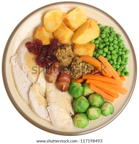 Traditional roast turkey Christmas dinner with all the trimmings. - stock photo