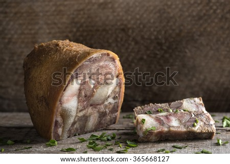 Traditional Romanian food - Pork aspic on wooden table - stock photo