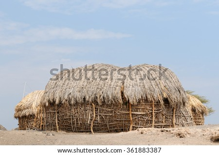 Traditional round house of people from the Turkana tribe on the shore of the lake Turkana in Kenya  - stock photo