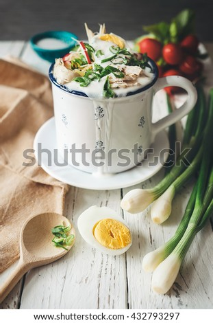 "Traditional russian cold summer soup ""okroshka"" in big mug - stock photo"