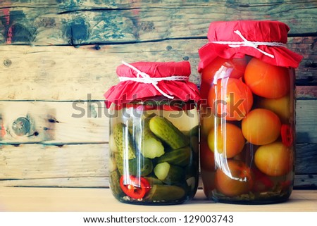 Traditional russian cuisine - marinated cucumbera and tomatos - stock photo