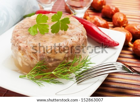 Traditional Russian food. Aspic chicken jelly with dill. - stock photo