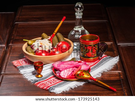 Traditional russian pickled vegetables in painted wooden tableware - stock photo