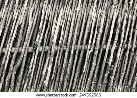 Traditional russian village's wooden wattled fence background - stock photo