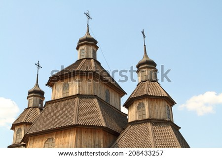 traditional russian wooden church against the  sky  - stock photo
