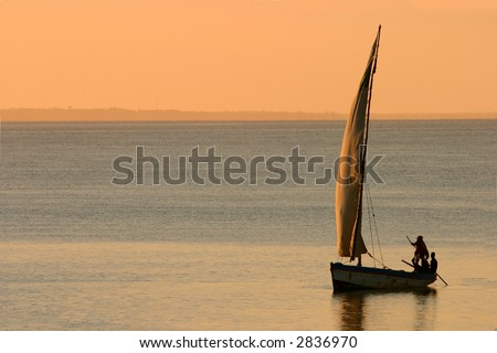 Traditional sail boat called a dhow at sunset, Vilanculos coastal sanctuary, Mozambique - stock photo