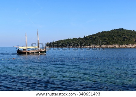 Traditional sailing ship in front of Lokrum Island. Lokrum is small picturesque island near Dubrovnik, Croatia. - stock photo