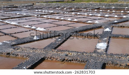 Traditional salt production in Salinas del Carmen on the island Fuerteventura one of the Canary islands belonging to Spain - stock photo