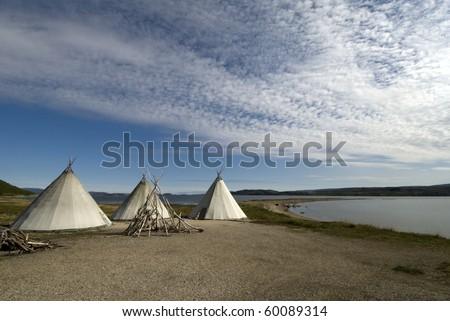 Traditional Sami reindeer-skin tent in Finnmark region of Norway - stock photo