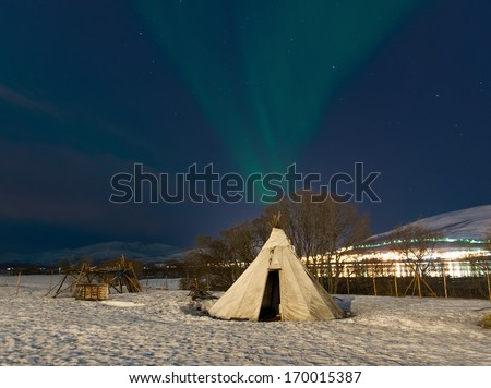 Traditional Sami reindeer-skin tents (lappish yurts) in Troms region of Norway  - stock photo
