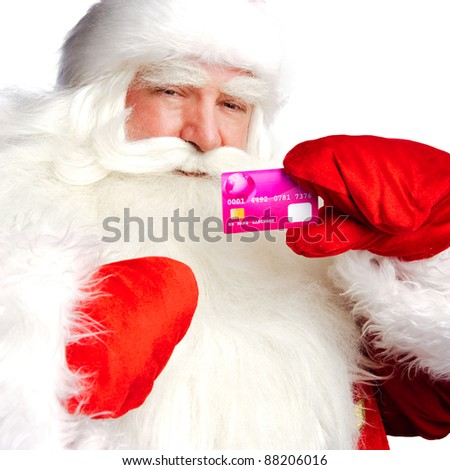 "Traditional Santa Claus holding and sowing credit card while giving a big ""ho ho ho"" belly laugh. Isolated on white. - stock photo"