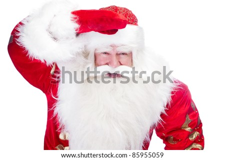 Traditional Santa Claus looking for children and holding his hand near head. Isolated on white. - stock photo