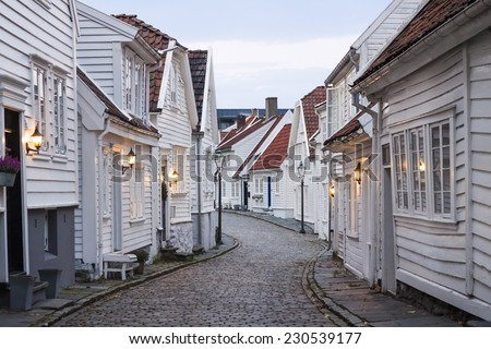 Traditional scandinavian cobblestone street with white houses in Stavanger, Norway - stock photo