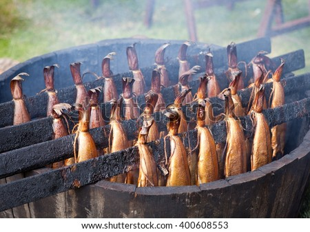 Traditional Scottish smoked fish cooking in wooden barrel - stock photo