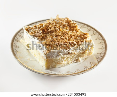 Traditional Serbian dessert, cream pie served on plate.  - stock photo