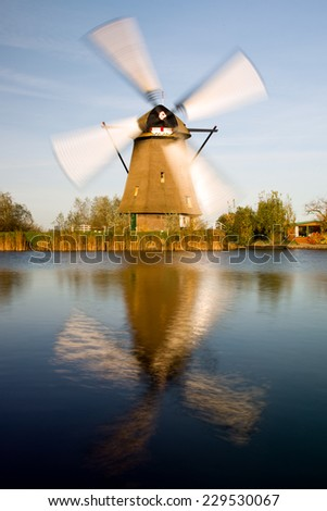 Traditional setting of the historical dutch windmills landscape at Kinderdijk near Rotterdam, the Netherlands, an UNESCO world heritage site - stock photo