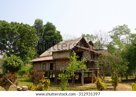 Traditional Shan house on stilts in rural village near  Hsipaw,  Myanmar (Burma) - stock photo