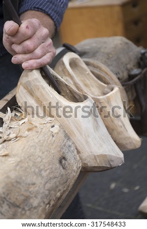Traditional skill of making Dutch wooden shoes - stock photo