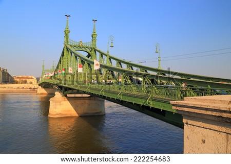 Traditional steel bridge painted green across Danube river, Budapest, Hungary - stock photo