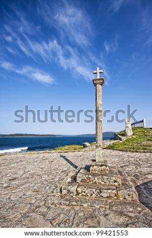 Traditional stone cross erected along the coast of Galicia in Muxia, La Coruna, Spain - stock photo