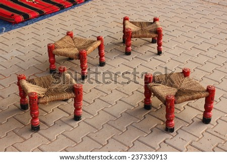 Traditional stools at a Sudanese street cafe - stock photo