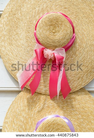 Traditional straw hats with ribbons - stock photo