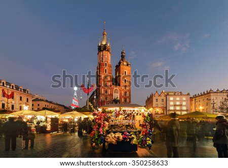 Traditional street market in Main Market Square of the Old City in Krakow, Poland at Christmas. - stock photo