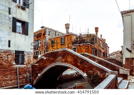 Traditional street view of old buildings in Venice, ITALY - stock photo