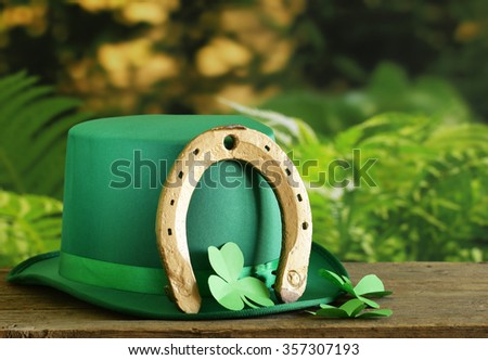 traditional symbols for Patrick's Day - green hat, horseshoe, clover - stock photo