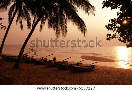 Traditional thai boat at evening beach of Pattaya, Thailand - stock photo