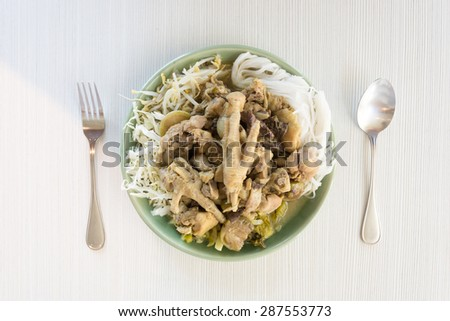 Traditional Thai cuisine, rice vermicelli eaten with chicken green curry. - stock photo