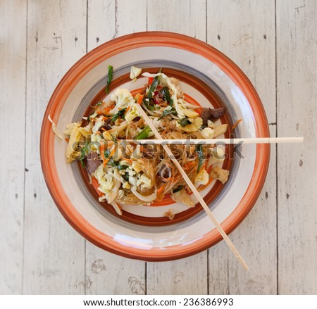 traditional Thai food, pad thai, fried noodles with vegetables and meat on the table - stock photo