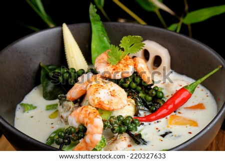 Traditional thai green curry with shrimps - stock photo