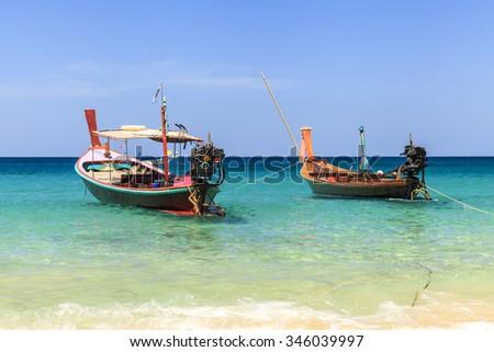 Traditional thai longtail boat at famous sunny Long Beach, Thailand, phuket province, Andaman sea - stock photo