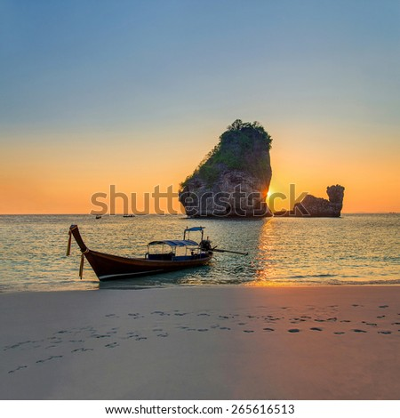 Traditional thai longtail boat at sunset Nui Bay Beach. Thailand, Krabi province. - stock photo