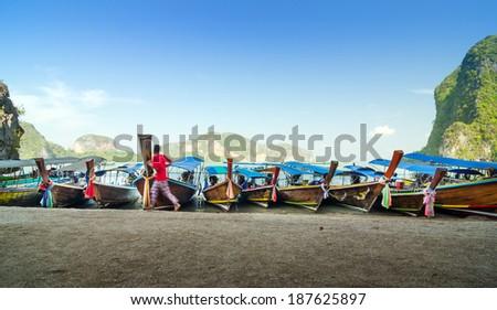 Traditional Thai Longtail boats at James Bond Island, Phang Nga, Thailand  - stock photo