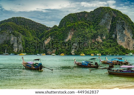 Traditional Thai Longtail boats on phi phi island , thailand ,  - stock photo