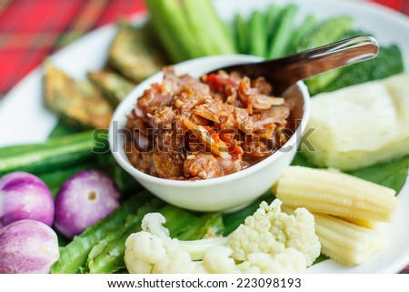Traditional Thai mix spicy sauce or Nam Prik in Thai name with mix vegetable - stock photo