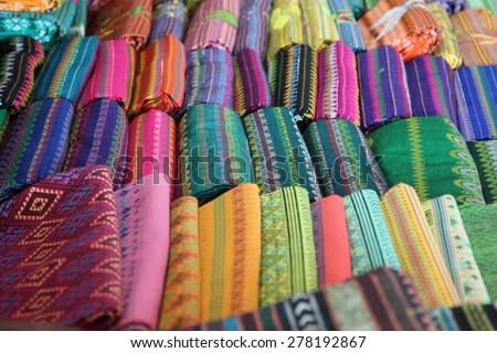 Traditional Thai silk cloth in fashion store. - stock photo