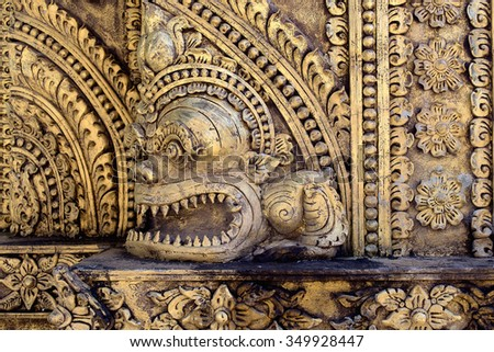 Traditional Thai stucco pattern decorative in Buddhist temple Chiang Rai, Thailand - stock photo