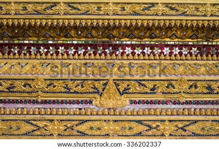 traditional Thai style art gold painting pattern on the door - stock photo