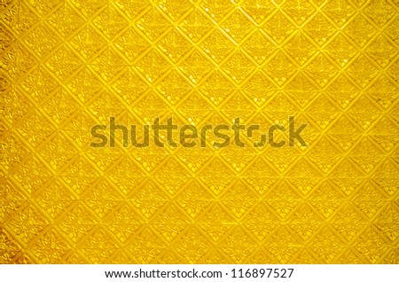 Traditional Thai style art gold painting pattern on wall in Temple Bangkok, Thailand - stock photo