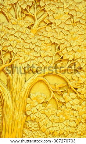 Traditional Thai style art golden tree carving on temple door - stock photo