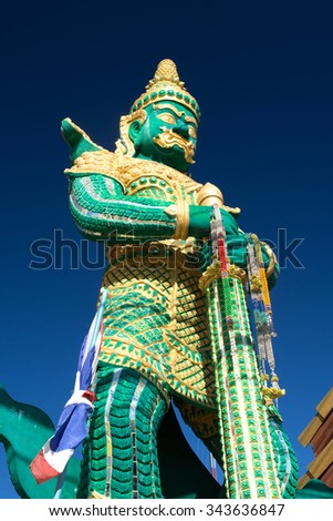 traditional thai style demon statue at Buddhist temple in Chiang Khong Chiang rai Thailand - stock photo
